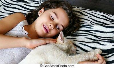 girl teenage stroking cat lying on bed love