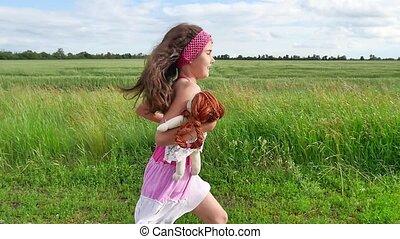 Girl teenager childhood. teenager girl with doll running...