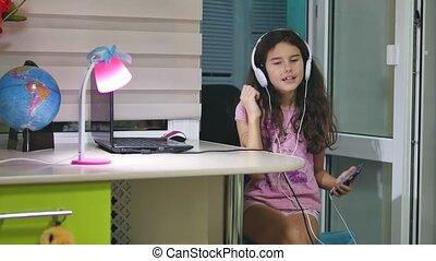 girl teenager dancing and singing in music headphones....