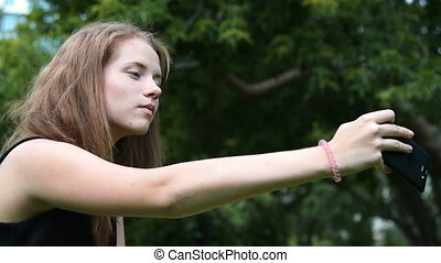 Girl teenager making selfie with mobile phone - Girl...