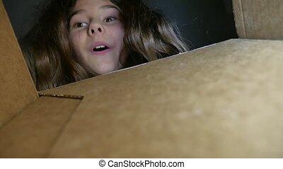 girl teenager opens cardboard box parcel. girl receives...