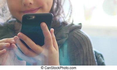 Girl teenager smartphone phone game online website the surfing