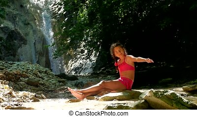 Girl teenager tourist in a swimsuit bathing in a mountain lake. Mountain river in the mountains forest wild beautiful nature landscape