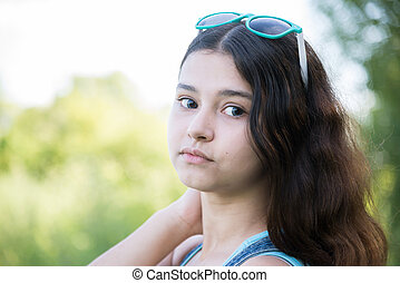 Girl teenager turned looking over shoulder