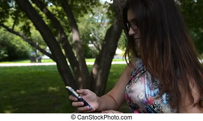 Girl teenager with cellphone outdoor