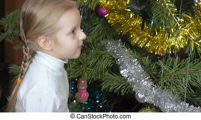Girl tells verse at Christmas tree - Girl child at Christmas...