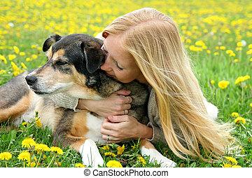 Girl Tenderly Hugging German Shepherd Dog