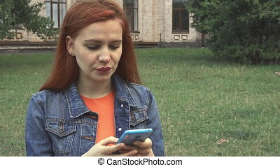 Girl texting and laughing