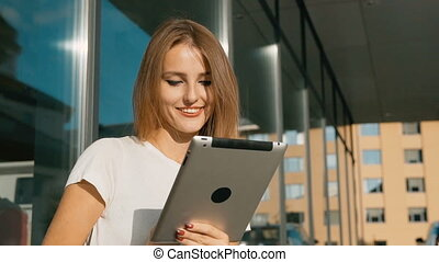 Girl Texting on Tablet