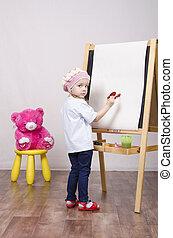 Girl, the artist draws on easel bear
