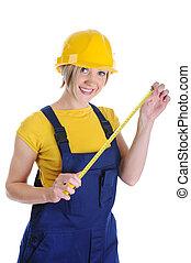 Girl the builder in a yellow helmet