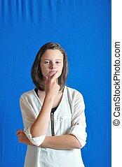 Girl thinking on blue background