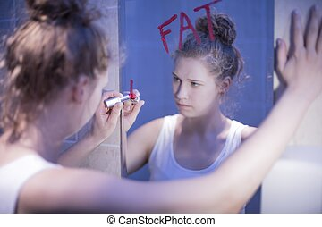 Girl thinking she is fat - Image of slim frustrated girl...