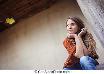 Girl thinking - Outdoor portrait of beautiful young sad girl...