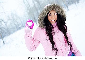 girl throwing a snowball