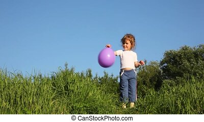 girl throwing up balloon