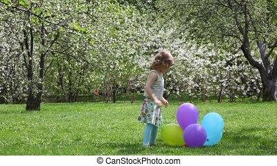 girl throws balls