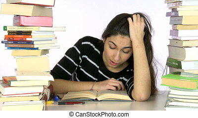 Girl tired of studying falls asleep