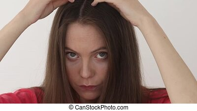 Girl touches her hair