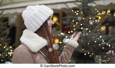 Girl Touching Christmas tree on the Street