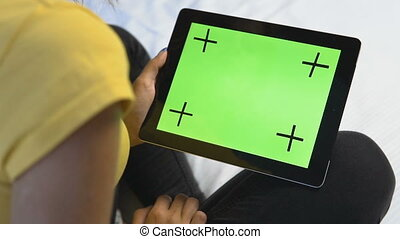 Girl Touching Green Tablet Screen - Young caucasian girl...