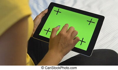 Girl Touching Tablet Screen - Young caucasian girl touching...