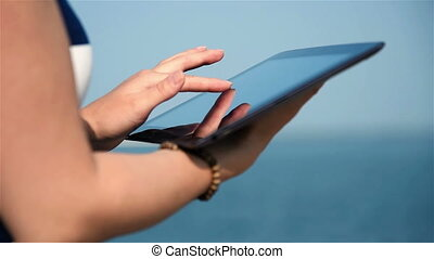 Girl Touching Touch Pad. Close Up. Slow Motion Effect