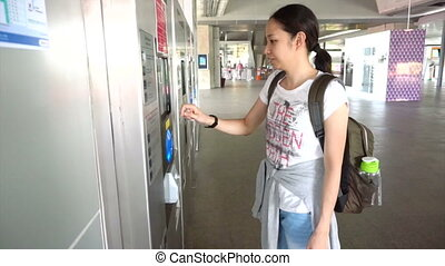 Girl tourist buying train ticket - Girl tourist buying...