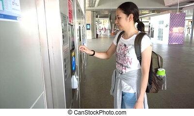Girl tourist buying train ticket - Girl tourist buying...