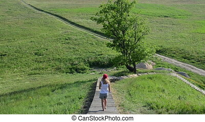 girl tourist hill mound - tourist woman girl descend wooden...