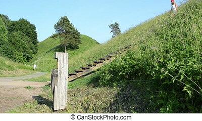 girl tourist hill mound