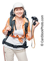 Girl tourist on a white background with binoculars and a backpack