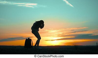 girl tourist resting halt silhouette at sunset sunlight slow...