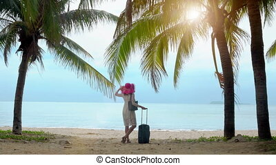 Girl tourist standing and looking at sea