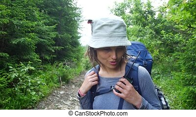 Girl tourist talking on the walkie-talkie.
