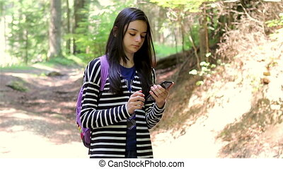 Girl tourist using smartphone