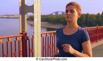 girl training cardio outdoors - caucasian woman athlete...