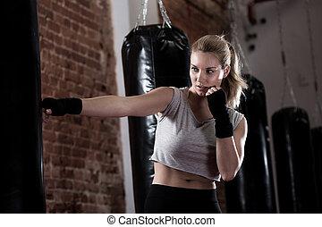 Girl training kick boxing - Horizontal view of girl training...