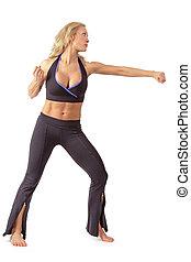 Athletic tanned blond girl training tae bo