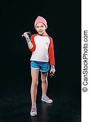 girl training with dumbbells isolated on black. action sport concept