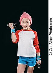 girl training with dumbbells isolated on black. athletics children concept
