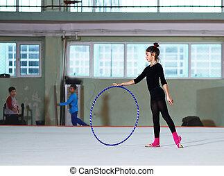 Girl training with hoop  rhythmic gymnastics
