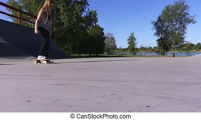 Girl training with skateboard on ramp