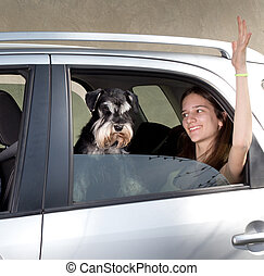 Girl traveling with dog in car