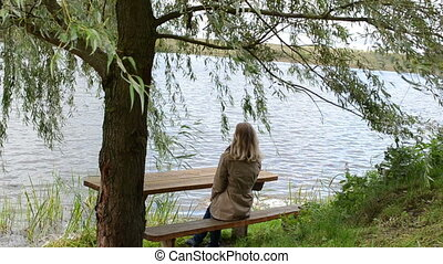 girl tree bench lake hair - young woman sit on bench near...