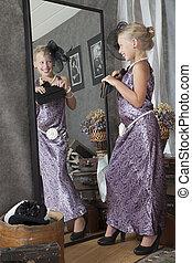 Girl try on a Grandma's dress