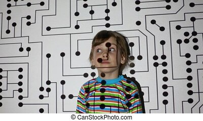 girl turns her eyes, looks in different directions and sways from side to side on a wall, which is projected electrical circuit