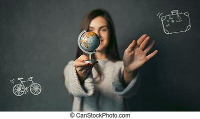Girl Turns the Globe