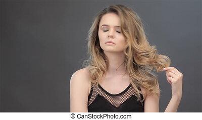 Girl twirls the hair