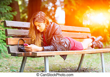 Girl typing on her phone